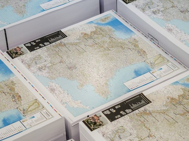 Piles of printed maps from Dennis Maps UK Map printer