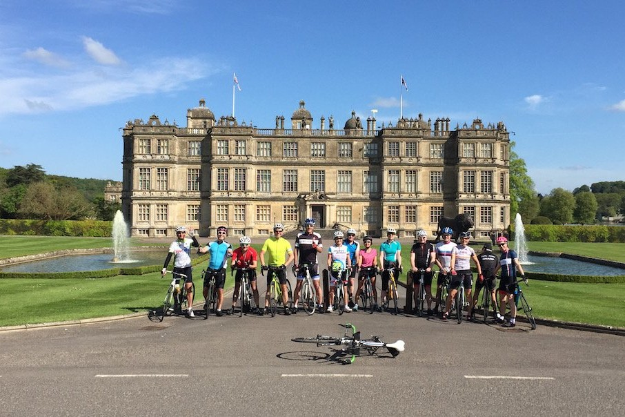 Road cycling maps - group of cyclists in front of Longleat House