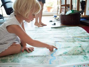 Girl looking at London National Park City Map