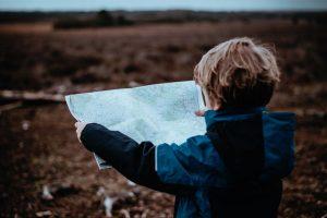 Walk Planning - little boy holding an os map